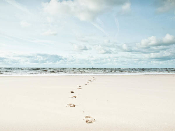 Horizontal Poster featuring the photograph Footprints Leading Into Sea by Dune Prints by Peter Holloway