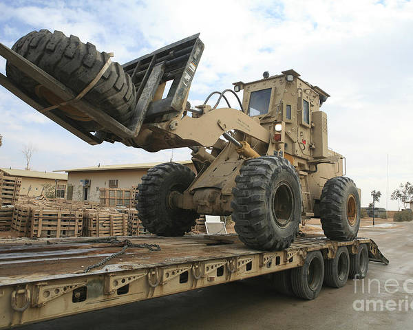 Horizontal Poster featuring the photograph Forklift Is Unloaded Off Of A Logistics by Stocktrek Images