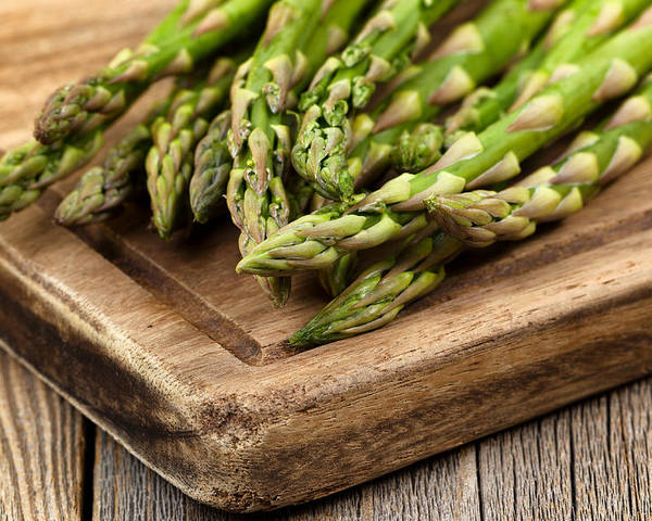 Asparagus Poster featuring the photograph Fresh Asparagus On Rustic Wooden Server Board by Thomas Baker