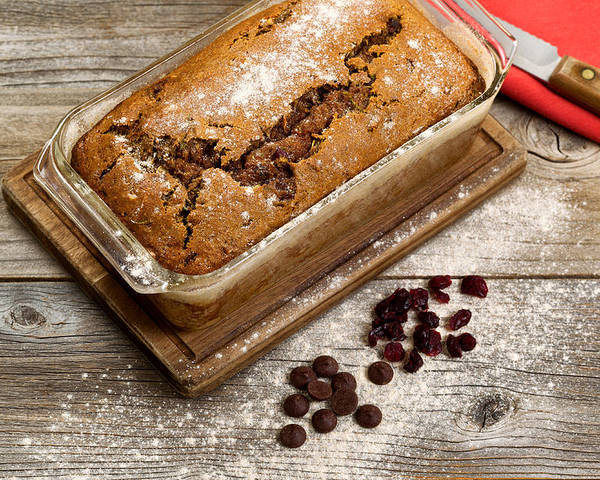 Bread Poster featuring the photograph Freshly Baked Zucchini Bread On Rustic Wooden Boards by Thomas Baker