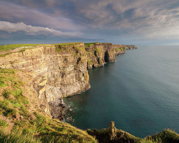 Ireland Poster featuring the photograph Golden Light At The Cliffs Of Moher by Pierre Leclerc Photography