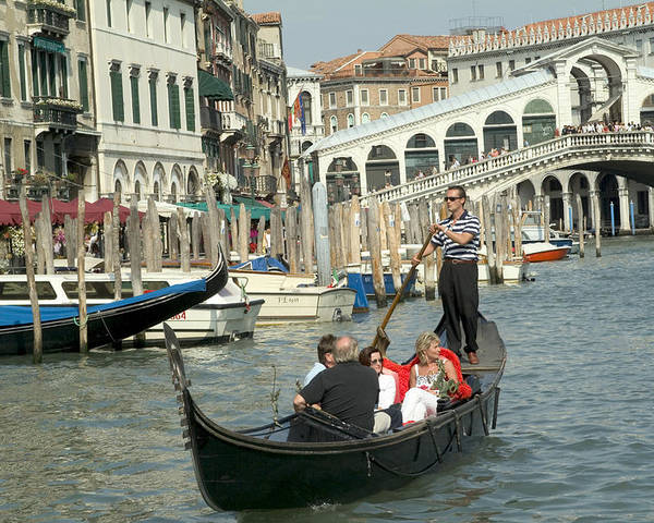 Venice Poster featuring the photograph Gonfolas On Venice Canal At Rialto Bridge by Charles Ridgway