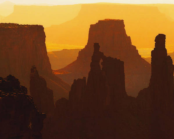 Desert Poster featuring the photograph Hazy Sunrise Over Canyonlands National Park Utah by Utah Images