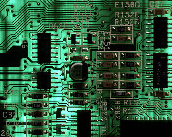 Circuit Board Poster featuring the photograph Integrated Circuit Board From A Computer by Sami Sarkis