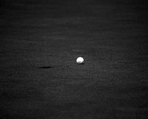 Golf Ball Hole Grass Black White Tee Golfball Poster featuring the photograph Just Shy by William Haney
