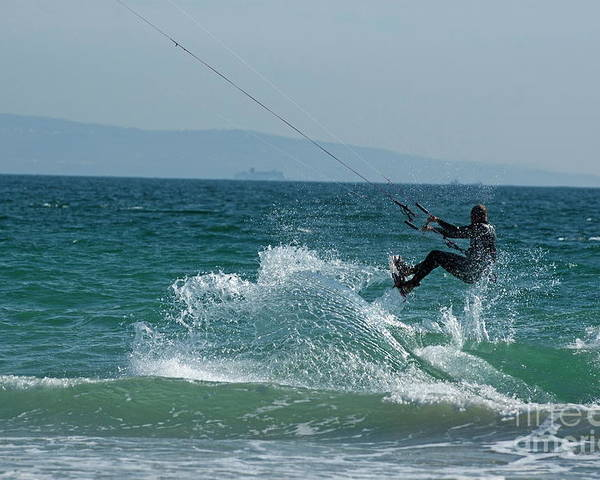 Abilities Poster featuring the photograph Kite Surfer Jumping Over A Wave by Sami Sarkis