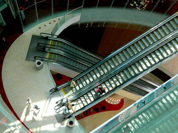Escalators Poster featuring the photograph Looking Down - Revel by Arlane Crump