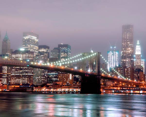 Horizontal Poster featuring the photograph Manhattan And Brooklyn Bridge Under Fog. by Shobeir Ansari