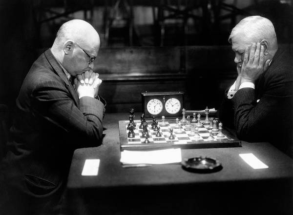 55-59 Years Poster featuring the photograph Mature Men Playing Chess, Profile (b&w) by Hulton Archive