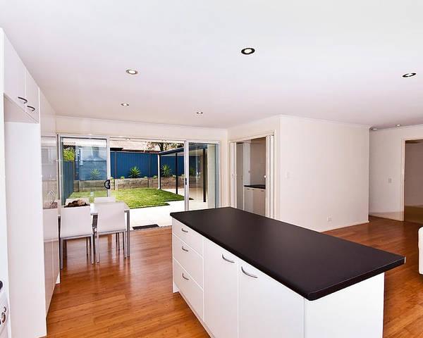 Real Estate Poster featuring the photograph Modern Kitchen by Darren Burton