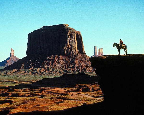 Man Poster featuring the photograph Monument Valley by Carl Purcell