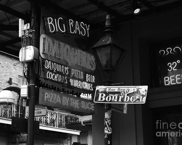 Travelpixpro Poster featuring the photograph Neon Sign On Bourbon Street Corner French Quarter New Orleans Black And White by Shawn O'Brien