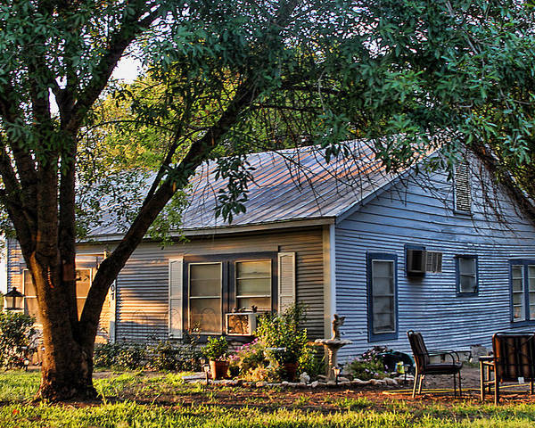 Architecture Poster featuring the photograph Nostalgic Old Cottage In Evening Light by Linda Phelps