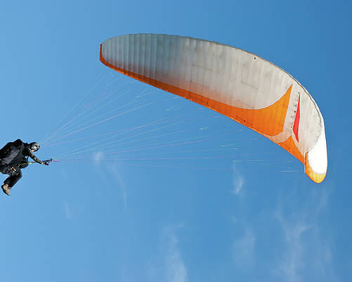 Para-glider Poster featuring the photograph Paraglider In The Blue by Yurix Sardinelly