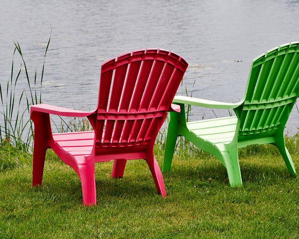 Chairs Poster featuring the photograph Pink And Green Lounging Chairs By The Lake by Louise Heusinkveld