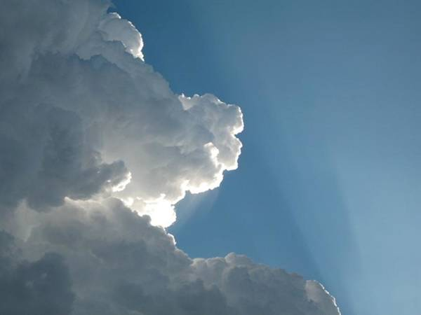 Clouds Poster featuring the photograph Puffy White Clouds by Liz Vernand