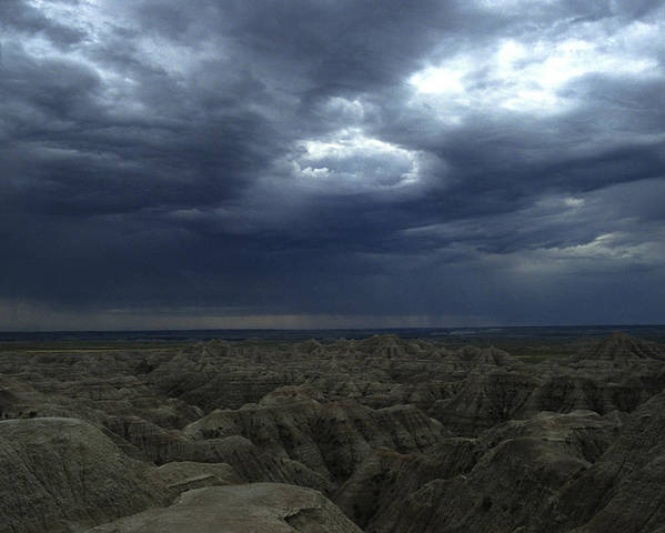 Badlands Poster featuring the photograph Rainy Sky Over The Badlands by Stacy Gold
