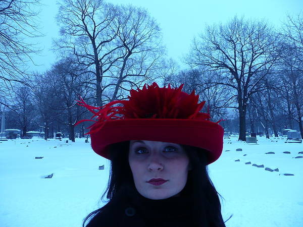 Cemetary Visit Made Festive By Alyssa Poster featuring the photograph Red Hat On A Blue Day by Cynthia Conte
