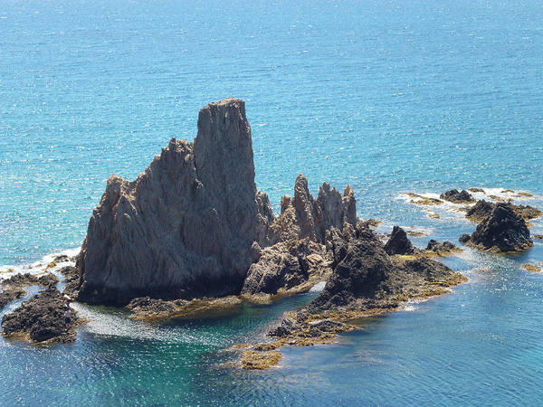 Almeria Poster featuring the photograph Rock Island by Laura Greco