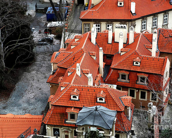 Roofs In Prague Poster featuring the photograph Roofs In Prague by John Rizzuto