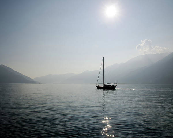 Horizontal Poster featuring the photograph Sailing Boat In Alpine Lake by Mats Silvan