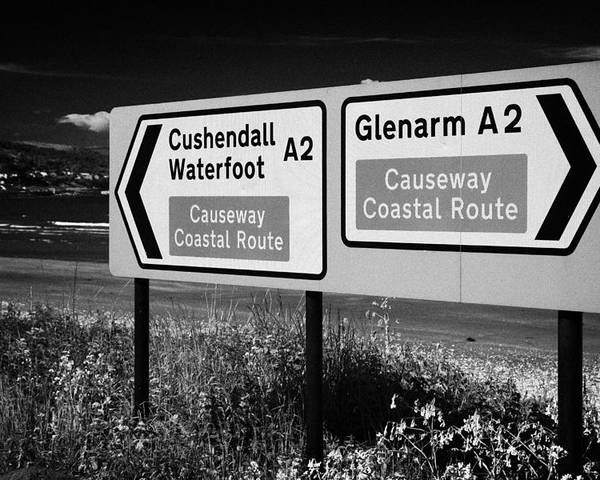 Sign Poster featuring the photograph Signposts For The Causeway Coastal Route At Carnlough Between Cushendall And Glenarm County Antrim by Joe Fox