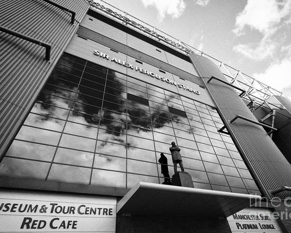Manchester Poster featuring the photograph sir alex ferguson stand Manchester united old trafford stadium uk by Joe Fox