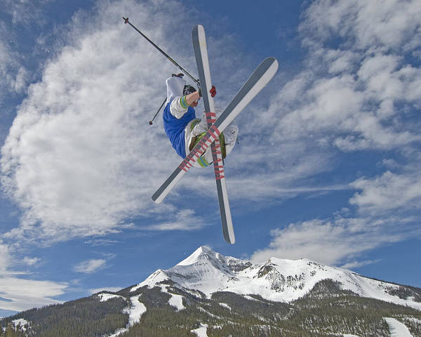 Outdoors Poster featuring the photograph Skiing Aerial Maneuvers Off A Jump by Gordon Wiltsie