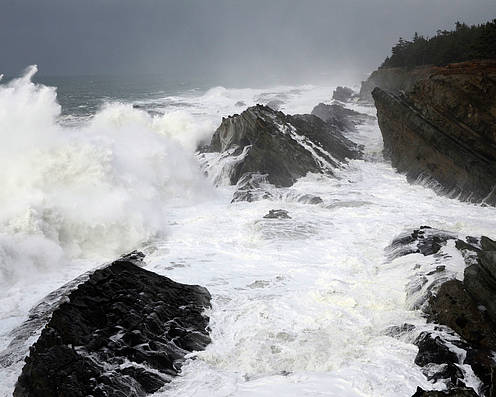 Lighthouse Poster featuring the photograph Storm On The Oregon Coast by Bob Christopher