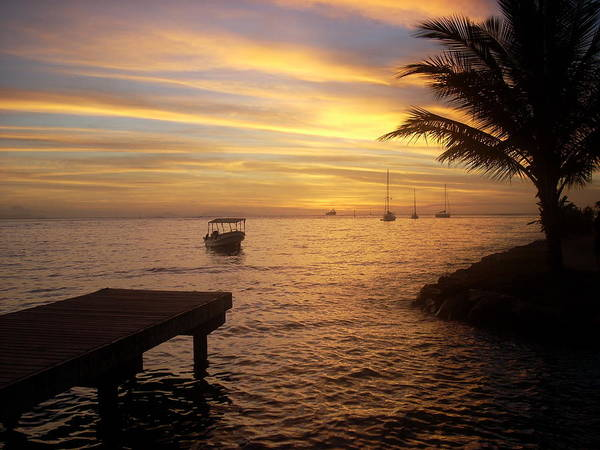 Sunset At The Dock In Fare Poster featuring the photograph Sunset In Huahine by Ileana Carreno