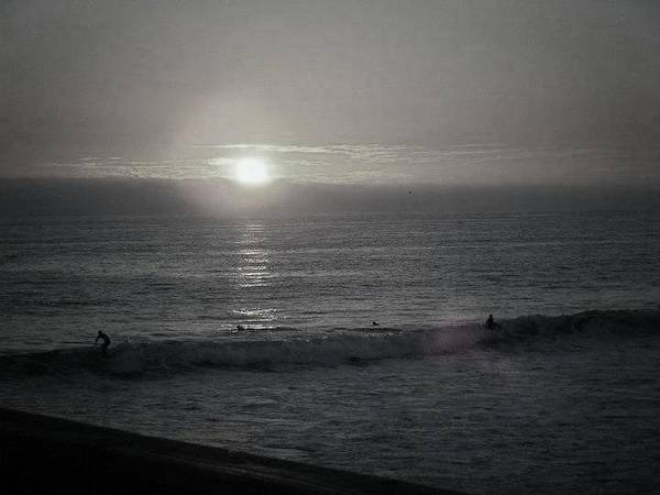Surfers Poster featuring the photograph Surf Until Sunset by Melody Glennon