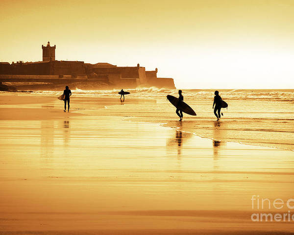 Action Poster featuring the photograph Surfers Silhouettes by Carlos Caetano