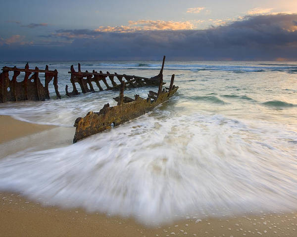 The Shipwreck Of The S. S. Dicky On A Sunshine Coast Beach In Australia. A 40 Ton Steamer Ran Aground In 1893. The Sea Has Gradually Carved Away At It After Over 110 Years Of The Waves Washing Over It. A Glorious Sunrise Helped Illuminate It As The Tides Began To Come In. Poster featuring the photograph Swept Ashore by Mike Dawson