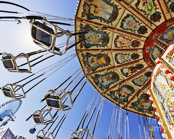 Below Poster featuring the photograph Swing Ride At The Fair by Jeremy Woodhouse