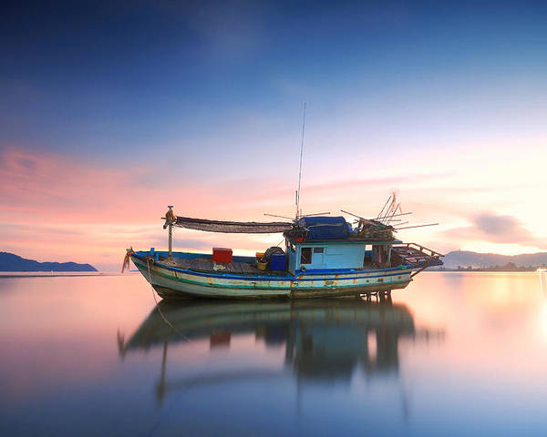 Beach Poster featuring the photograph Thai Fishing Boat by Teerapat Pattanasoponpong