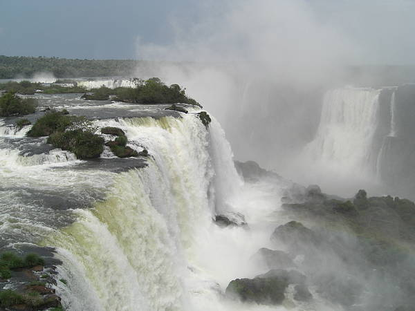 The Iguassu Channel At Iguassu Falls Devils Throat Poster featuring the photograph The Iguassu Channel by Paul Jessop