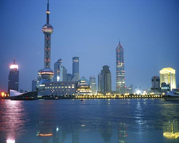 Scenes And Views Poster featuring the photograph The Shanghai Skyline And Riverfront by Raul Touzon