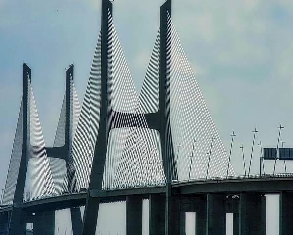 Vasco Da Gama Bridge Poster featuring the photograph Vasco da Gama Bridge in Lisbon by Kirsten Giving