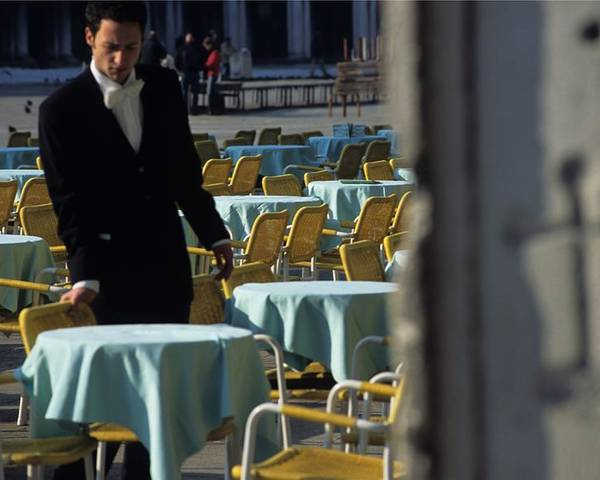 Venice Poster featuring the photograph Waiter Preparing For The Day In Piazza San Marco In Venice by Michael Henderson