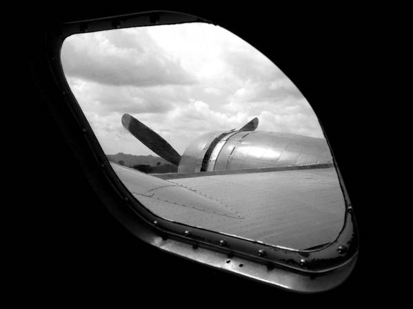 Airplane Poster featuring the photograph Wing And Window by Dan Holm