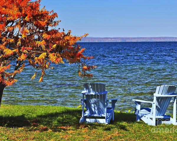 Lake Poster featuring the photograph Wooden Chairs On Autumn Lake by Elena Elisseeva