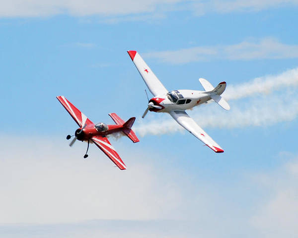Airplanes Poster featuring the photograph Yak 55 And Yak 18 by Larry Keahey