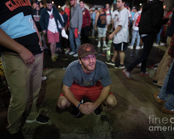 Facial Expression Poster featuring the photograph Cleveland Indians Fans Gather To The by Justin Merriman