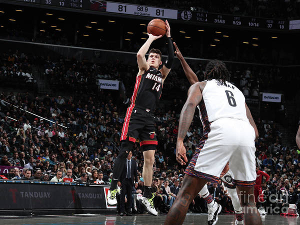 Tyler Herro Poster featuring the photograph Miami Heat V Brooklyn Nets by Nathaniel S. Butler