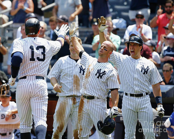 Three Quarter Length Poster featuring the photograph Kansas City Royals V New York Yankees by Al Bello