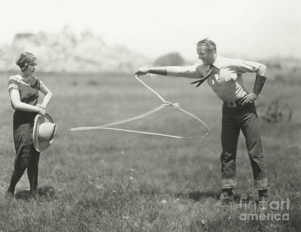 1920s Poster featuring the photograph Cowboy Showing Off His Roping Skills by Everett Collection