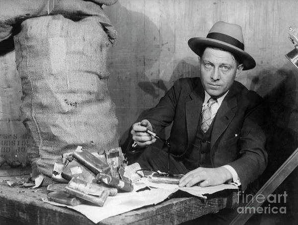 People Poster featuring the photograph Customs Officer Examining Confiscated by Bettmann