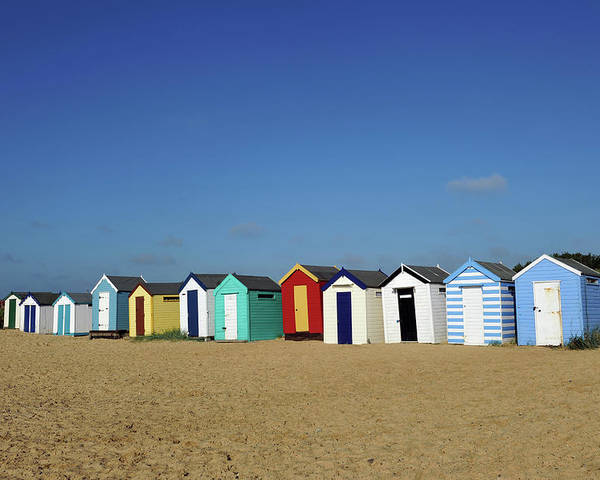 Beach Hut Poster featuring the photograph English Beach Huts by Oversnap