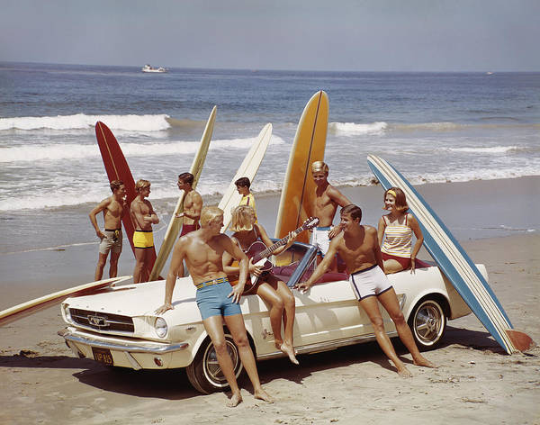Young Men Poster featuring the photograph Friends Having Fun On Beach by Tom Kelley Archive
