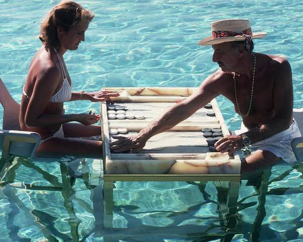 Straw Hat Poster featuring the photograph Keep Your Cool by Slim Aarons
